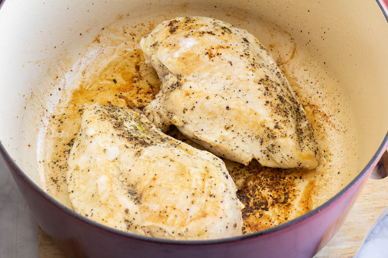 Searing chicken in olive oil, garlic, salt and pepper